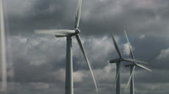 Wind turbine clouds time lapse moving fast with slow turbines - stock footage