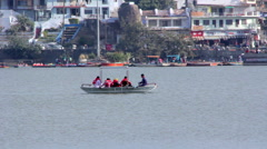 People ride on a boat on the lake. India - stock footage