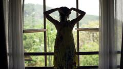 Young woman open window and admire view, super slow motion 240fps - stock footage