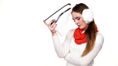 Woman dreaming about ice skating holds skate shoe 4K - stock footage