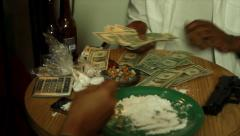 Drugs and money being sorted Stock Footage