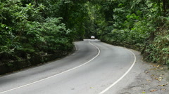 Auto traffic on narrow two-lane in Fern Gully rain forest, Jamaica Stock Footage