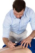 Physiotherapist doing accupuncture - stock photo