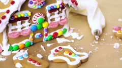 Building gingerbread house for Christmas. - stock footage
