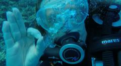 OK, Okay sign hand signal whilst Scuba Diving in clear Red Sea water Egypt - stock footage
