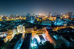 Stock Photo of View of the Ratchathewi District at night, in Bangkok, Thailand.