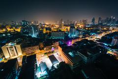View of the Ratchathewi District at night, in Bangkok, Thailand. - stock photo