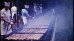 2988 - chefs attend to chicken on large barbecue grill - vintage film home movie Stock Footage