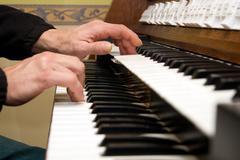 Organ keyboard and sheet music Stock Photos