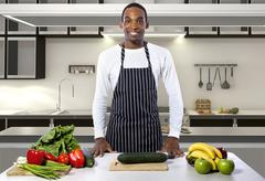 Male Chef is a Domestic or Commercial Kitchen Stock Photos