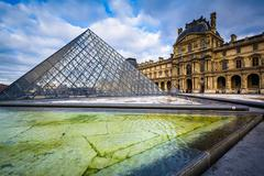 The Louvre Pyramid, in the courtyard of the Louvre Palace, in Paris, France. - stock photo