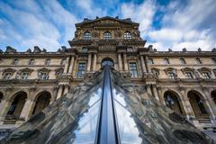 The Louvre Pyramid, in the courtyard of the Louvre Palace, in Paris, France. Stock Photos