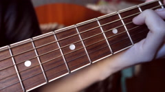 Fingers clamped chords on the fingerboard - stock footage