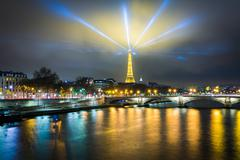 The Eiffel Tower and Seine at night, in Paris, France. - stock photo