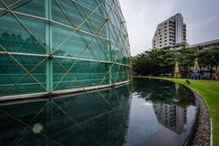 Stock Photo of Pool and round glass building at the King Power Complex in Bangkok, Thailand.