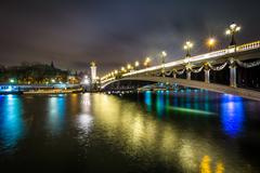 Pont Alexandre III and the Seine at night, in Paris, France. - stock photo