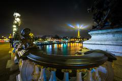 Pont Alexandre III and the Eiffel Tower at night, in Paris, France. - stock photo