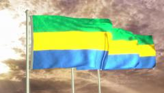 Three flags of Gabon waving in the wind (4K) Stock Footage