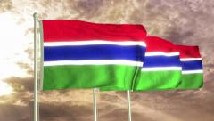 Three flags of Gambia waving in the wind (4K) Stock Footage