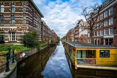 Houseboats in the Lijnbaansgracht canal, in Amsterdam, The Netherlands. - stock photo