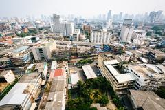 Hazy view of the Ratchathewi District, in Bangkok, Thailand. - stock photo
