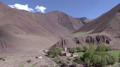 View over traditional village in arid ladakhian Himalayan valley Stock Footage