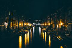 A canal at night, in Amsterdam, Netherlands. - stock photo