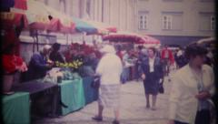 2997 - tourist walk the open street market in Italy - vintage film home movie Stock Footage