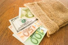 International currencies bank note in the sack - stock photo