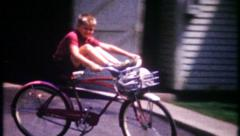 2999 - children show off their bicycle riding skills - vintage film home movie Stock Footage