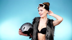 Woman seductive girl in ski googles holds helmet. 4K Stock Footage