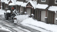 Snow Plow Clearing Neighborhood Street. - stock footage