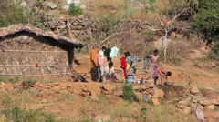 Rural Indian family near his home - stock footage