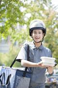 Stock Photo of Take-out deliveryman