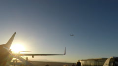 Boeing 737-700 at Hurghada International Airport with other plane in air in BG Stock Footage