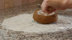A woman rolls out dough to make gingerbread men Stock Footage