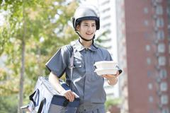 Take-out deliveryman - stock photo
