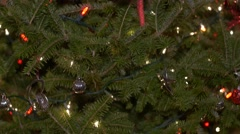 Tilt up chirstmas tree to red and green bulbs-close up Stock Footage