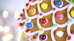 Gingerbread house decorated with white royal icing and bright candies. Stock Footage