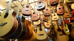 Many guitar sels in Khao San road in BKK city Stock Footage