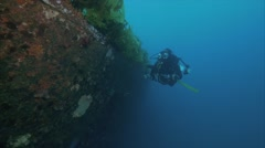 Diver on wreck Stock Footage