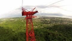 View to the mast and the Puerto Plata city from the moving cable car gondola. Stock Footage