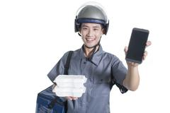 Take-out deliveryman showing smart phone Stock Photos