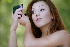 Young woman close-up colors lashes mascara Stock Photos