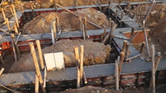 Panning shot of pillar and beam being constructed at the construction site Stock Footage