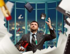 Businessman with stationery - stock photo