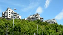view of the modern houses on the hill above the city - sunny day - stock footage