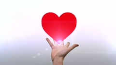 Red Heart on a hand Stock Footage