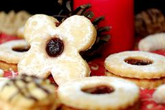 Christmas cookies in the background with a candle, sweets, pastry, sugar, hap Stock Photos