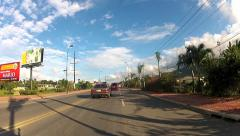 View from the car driving by the asphalt road in Puerto Plata. Stock Footage